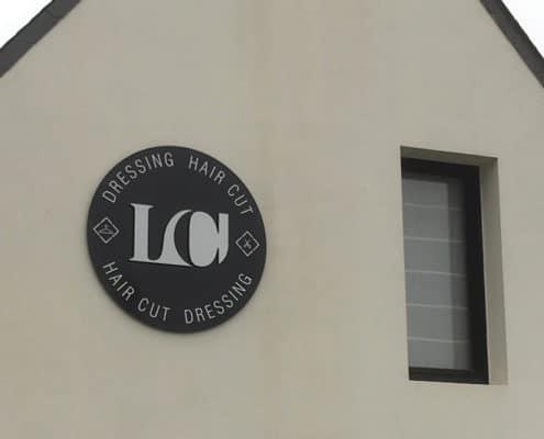 Enseigne ronde pour le concept dressing hair cut à Quiberon